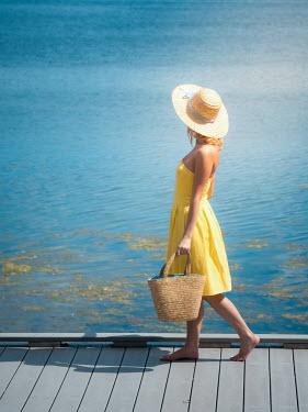 Elisabeth Ansley BAREFOOT GIRL IN HAT WALKING BY SEA Women