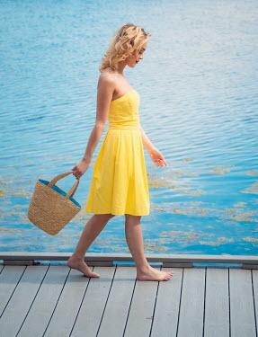 Elisabeth Ansley BAREFOOT GIRL WITH BAG WALKING BY SEA Women