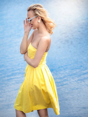 Elisabeth Ansley HAPPY BLONDE WOMAN BY SEA WITH SUNGLASSES Women