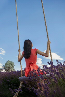 Nikaa WOMAN ON SWING WITH LAVENDER BUSHES Women