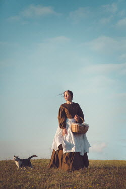 Joanna Czogala HISTORICAL WOMAN WITH BASKET AND CAT IN COUNTRYSIDE Women