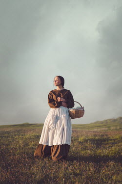 Joanna Czogala HISTORICAL WOMAN IN COUNTRYSIDE CARRYING BASKET Women