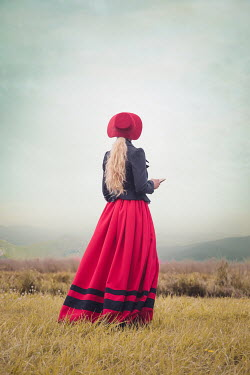 Joanna Czogala BLONDE HISTORICAL WOMAN WITH BOOK IN COUNTRYSIDE Women
