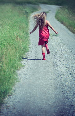Carmen Spitznagel BLONDE GIRL RUNNING ON COUNTRY ROAD IN SUMMER Children