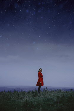 Shelley Richmond WOMAN IN RED COAT IN COUNTRYSIDE WITH STARRY SKY Women