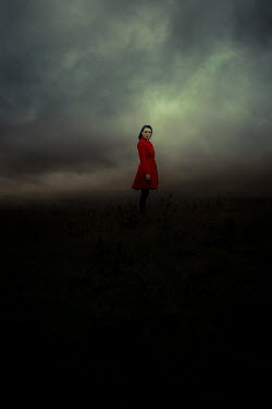 Shelley Richmond WOMAN IN RED COAT IN STORMY COUNTRYSIDE Women