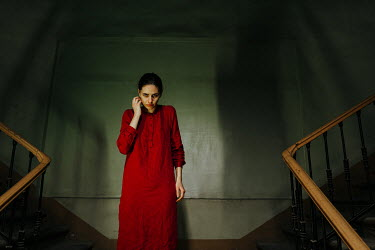 Daniil Kontorovich STARING WOMAN IN RED ON STAIRCASE IN SHADOW Women