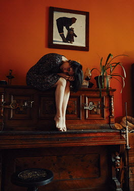 Daniil Kontorovich BAREFOOT WOMAN SITTING ON PIANO IN HOUSE Women