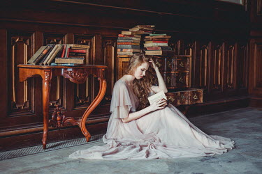Daniel Bidiuk GIRL SITTING WITH BOOKS IN GRAND HOUSE Women