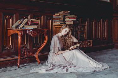Daniel Bidiuk GIRL SITTING WITH BOOKS IN GRAND HOUSE Women