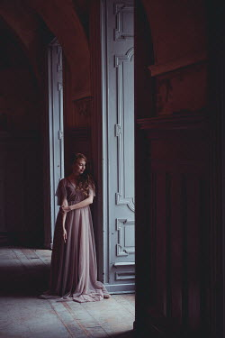 Daniel Bidiuk WOMAN IN SILK DRESS STANDING IN GRAND HOUSE Women