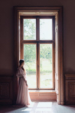 Daniel Bidiuk WOMAN IN DRESS BY WINDOW IN GRAND HOUSE Women