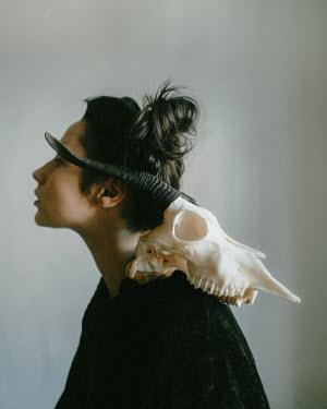 Daniil Kontorovich Young woman with animal skull