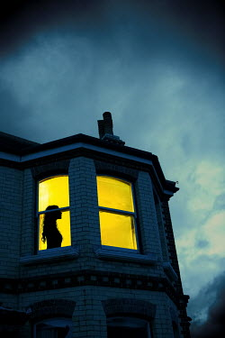 Magdalena Russocka silhouette of woman in bedroom window at night