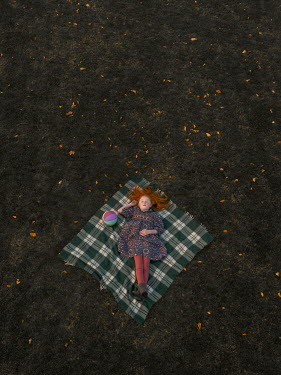 Mary Wethey Girl sleeping on picnic blanket