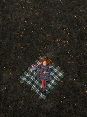 Mary Wethey Girl sleeping on picnic blanket