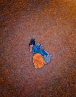 Mary Wethey Woman sleeping in field