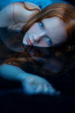 Rekha Garton Young woman lying in water