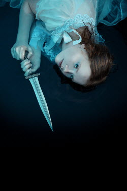 Rekha Garton Young woman with dagger lying in water
