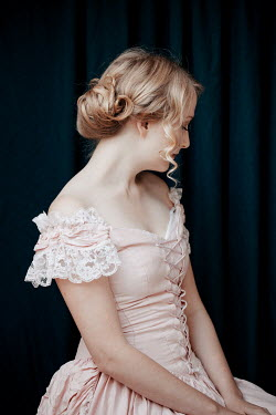 Rekha Garton Young woman with Victorian pink dress