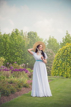 Joanna Czogala Young woman in Victorian sun hat and dress in field
