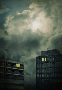 Lyn Randle Apartment buildings under clouds