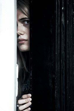 Miguel Sobreira Woman peeking behind door