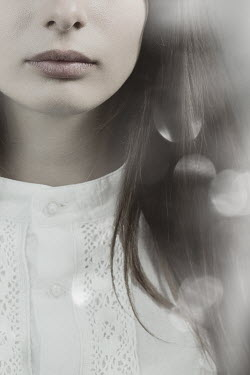 Magdalena Russocka close up of young woman in white blouse