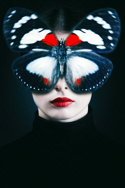Magdalena Russocka young woman with butterfly on face