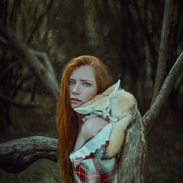 Anya Anti Young woman with freckles with fennec fox
