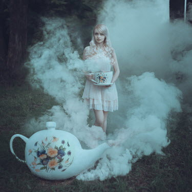 Anya Anti Young woman with oversized tea cup and tea pot