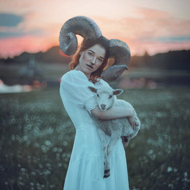 Anya Anti Woman with ram horns holding lamb