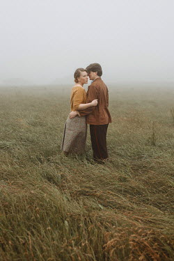 Shelley Richmond 1940s couple embracing in field