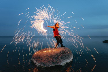 Daniil Kontorovich GIRL ON ROCK IN SEA WITH FIREWORK Women