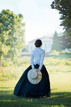 Ildiko Neer Victorian woman in garden by house in summer Women