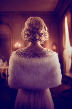 ILINA SIMEONOVA BLONDE WOMAN WITH FUR STOLE IN GRAND HOUSE Women
