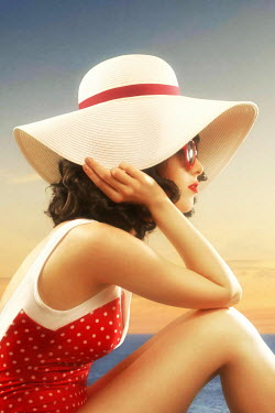 ILINA SIMEONOVA BRUNETTE WOMAN IN HAT SITTING ON BEACH Women