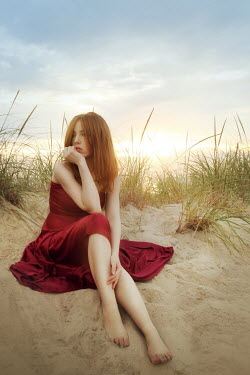 ILINA SIMEONOVA GIRL IN RED DRESS SITTING IN SAND DUNE AT SUNSET Women