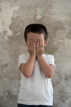 Mohamad Itani LITTLE BOY COVERING FACE WITH HANDS BY WALL Children