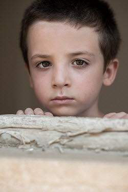 Mohamad Itani SAD LITTLE BOY BY SHABBY WINDOW Children