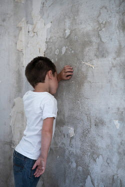 Mohamad Itani SAD LITTLE BOY LEANING ON SHABBY WALL Children