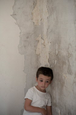 Mohamad Itani SAD LITTLE BOY BY WEATHERED WALL Children
