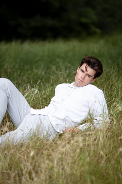 Miguel Sobreira Young Man Lying on Grass
