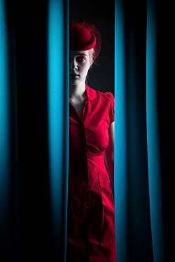 Magdalena Russocka WOMAN IN RED HIDING BEHIND BLUE CURTAINS Women