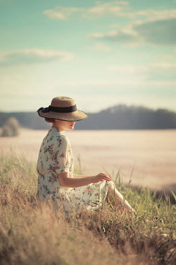 Ildiko Neer Vintage woman sitting countryside