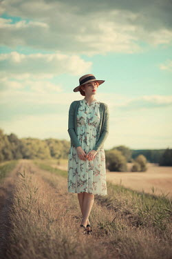 Ildiko Neer Vintage woman standing countryside