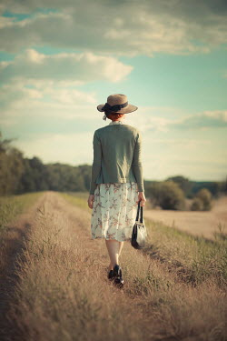 Ildiko Neer Vintage woman walking countryside
