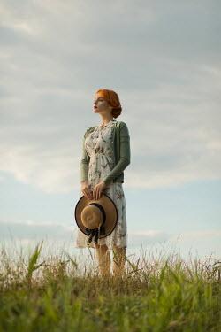Ildiko Neer Vintage woman standing in grass