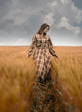 Jaroslaw Blaminsky WOMAN IN TARTAN GOWN STANDING IN WHEAT FIELD Women