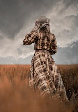 Jaroslaw Blaminsky WOMAN IN TARTAN DRESS AND HAT IN WHEAT FIELD Women